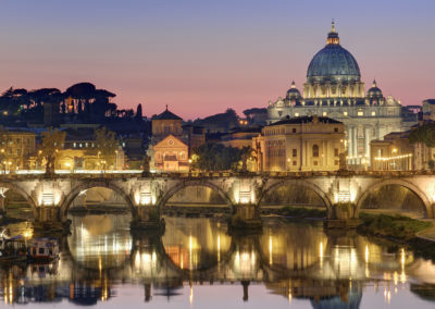 Italy, Lazio, Rome, historical center lited as World Heritage by UNESCO, Sant' Angelo bridge (Sant' Angelo ponte) above Tiber river and Saint Peter's basilica
